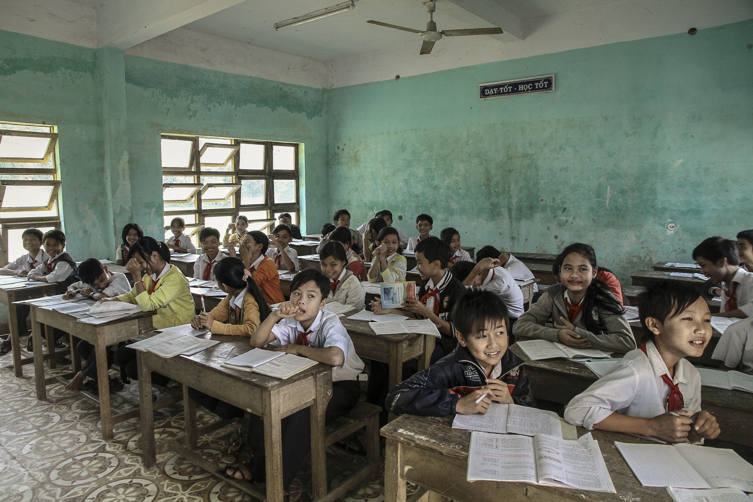 Young kids distracted in class. Hoi An, Vietnam
