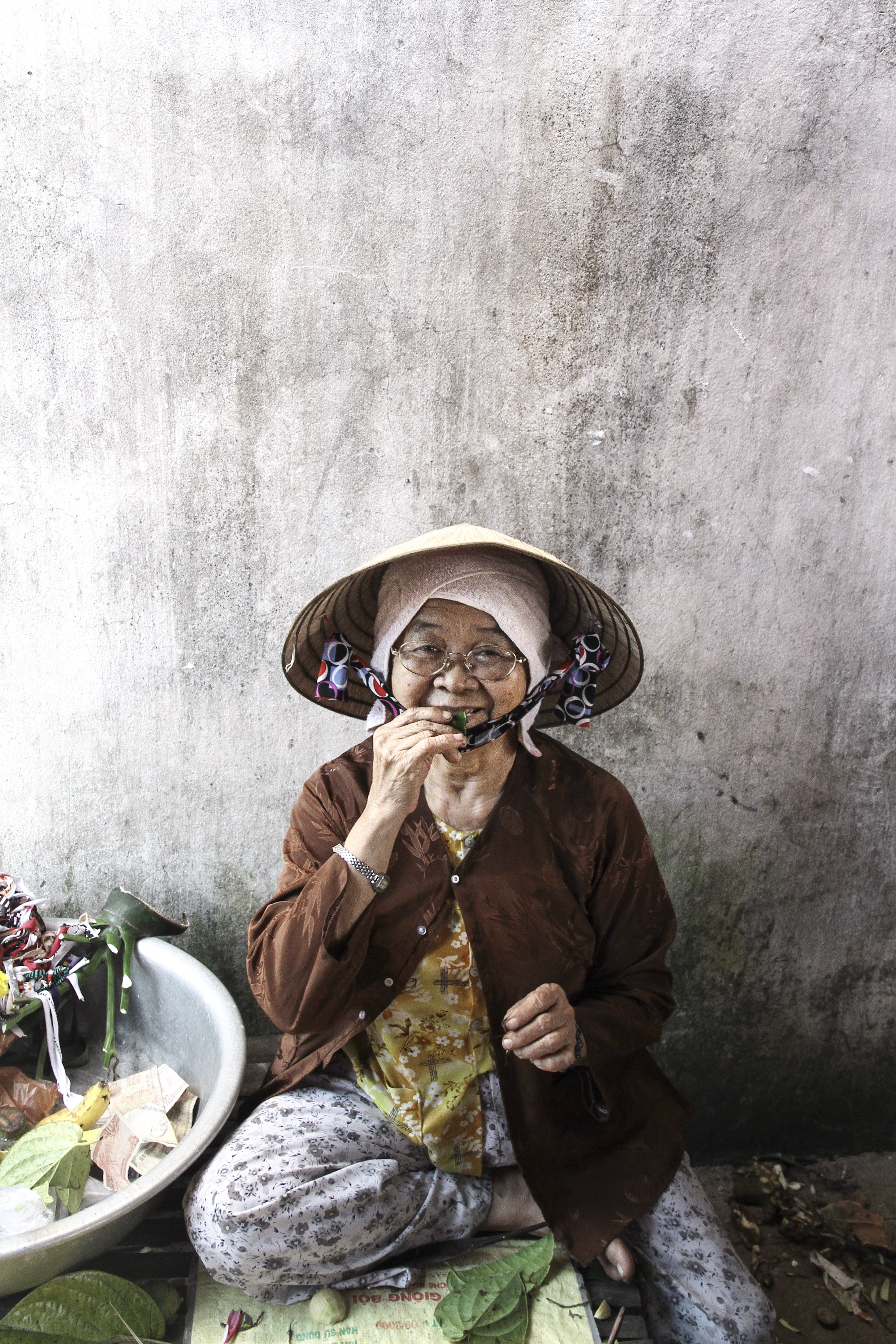 Farmer selling her produce at the market. Hoi An, Vietnam