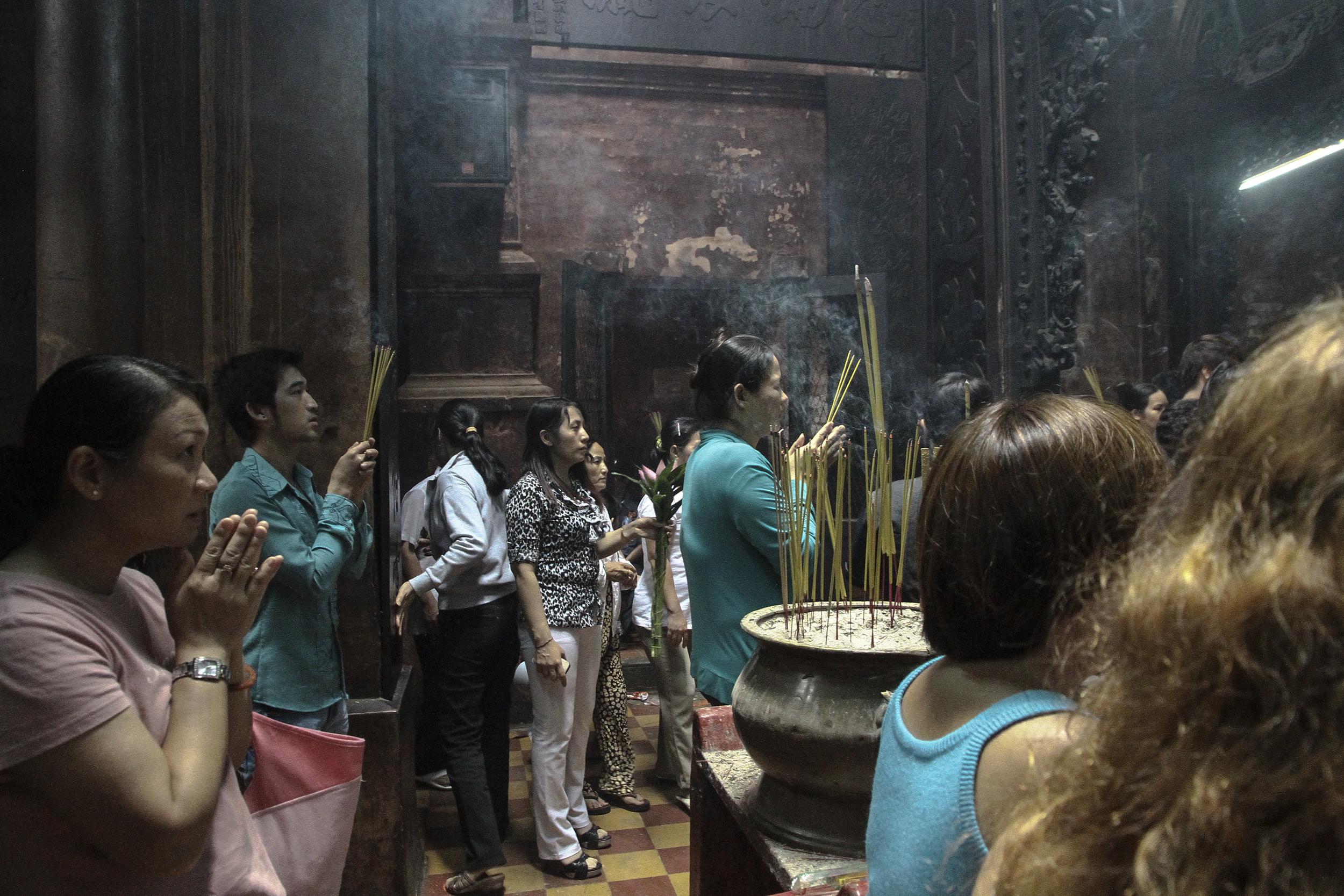 Praying. Ho Chi Minh City, Vietnam