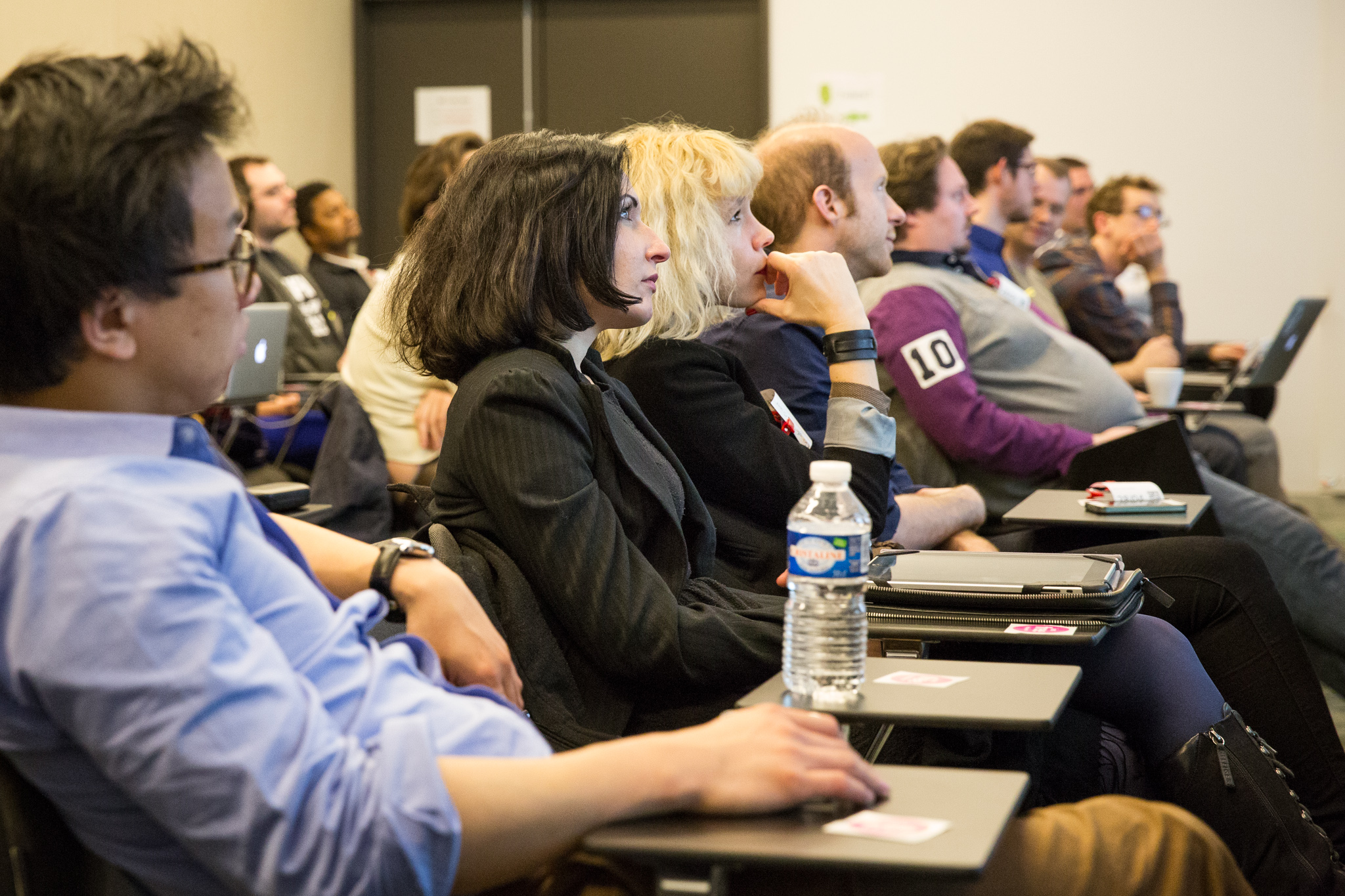 people listening to speaker at lecture