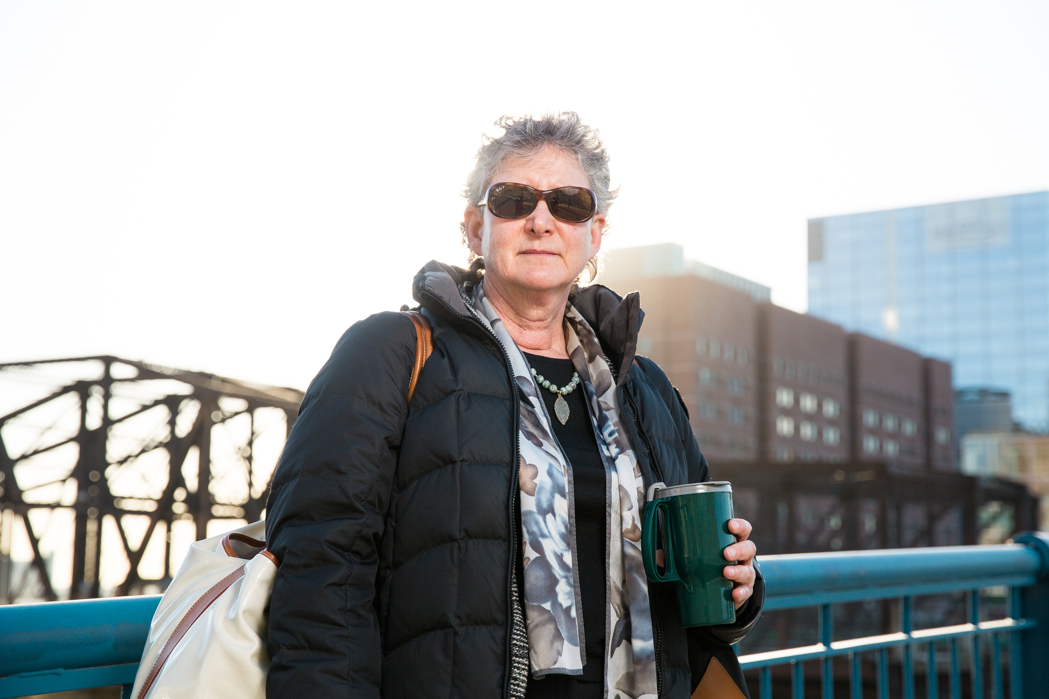 woman-on-bridge-with-coffee.jpg