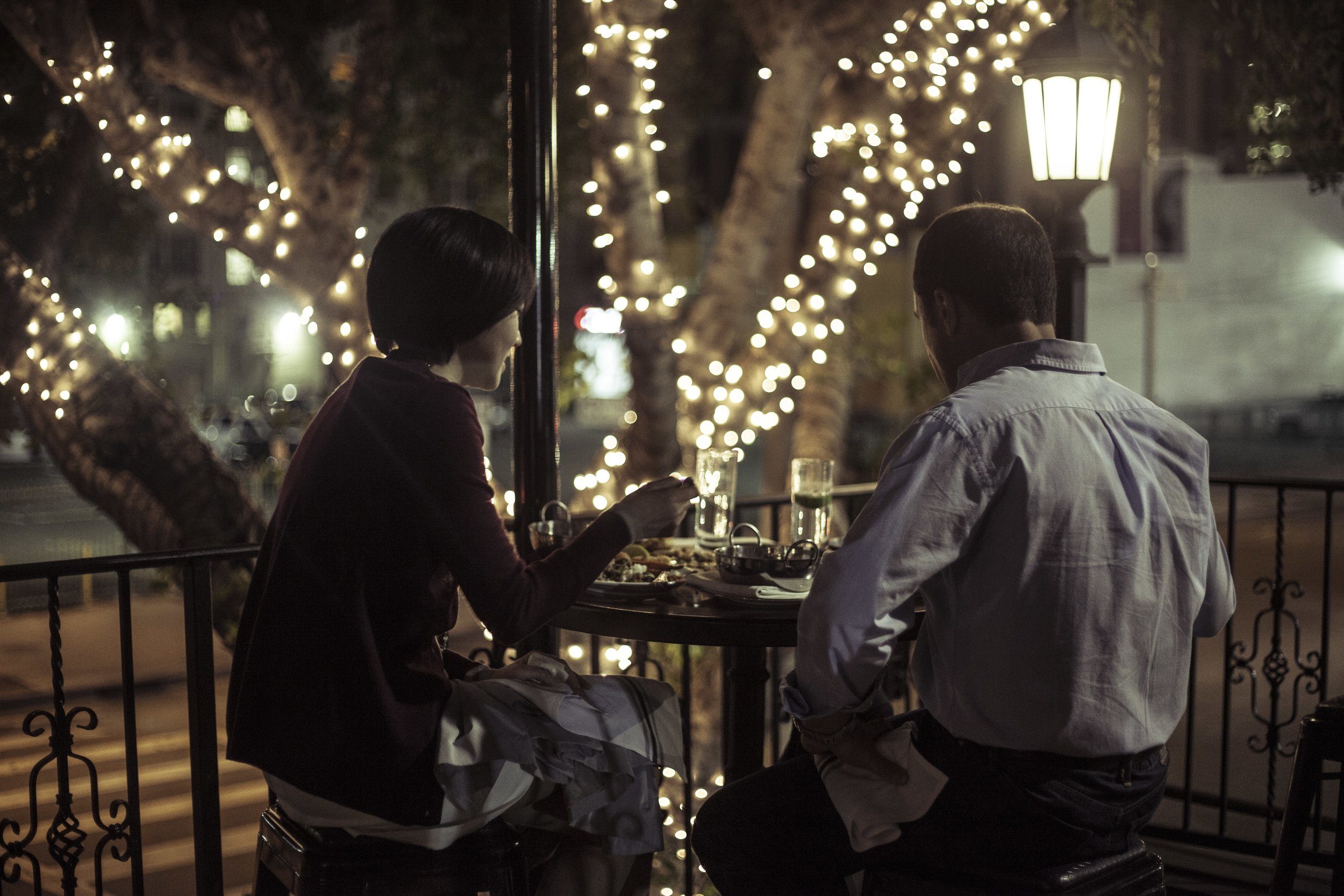 Couple Dining on Balcony at night