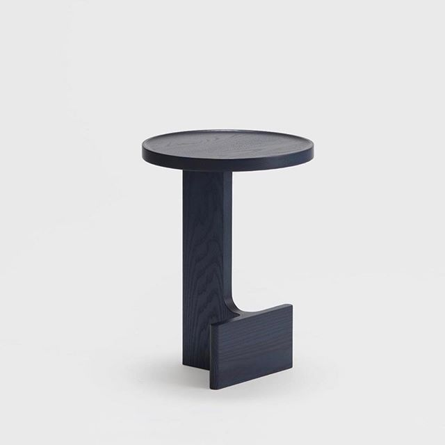 Beam side table designed by Staffan Holm for @ariake_collection. It comes in natural laquer, real indigo dye, and sumi black which is Japanese black inc. This sculptural table has a flat side that stands nice and close to your sofa. @staffanholmstudio @ariake_collection photo @sebastianstadler.jpg