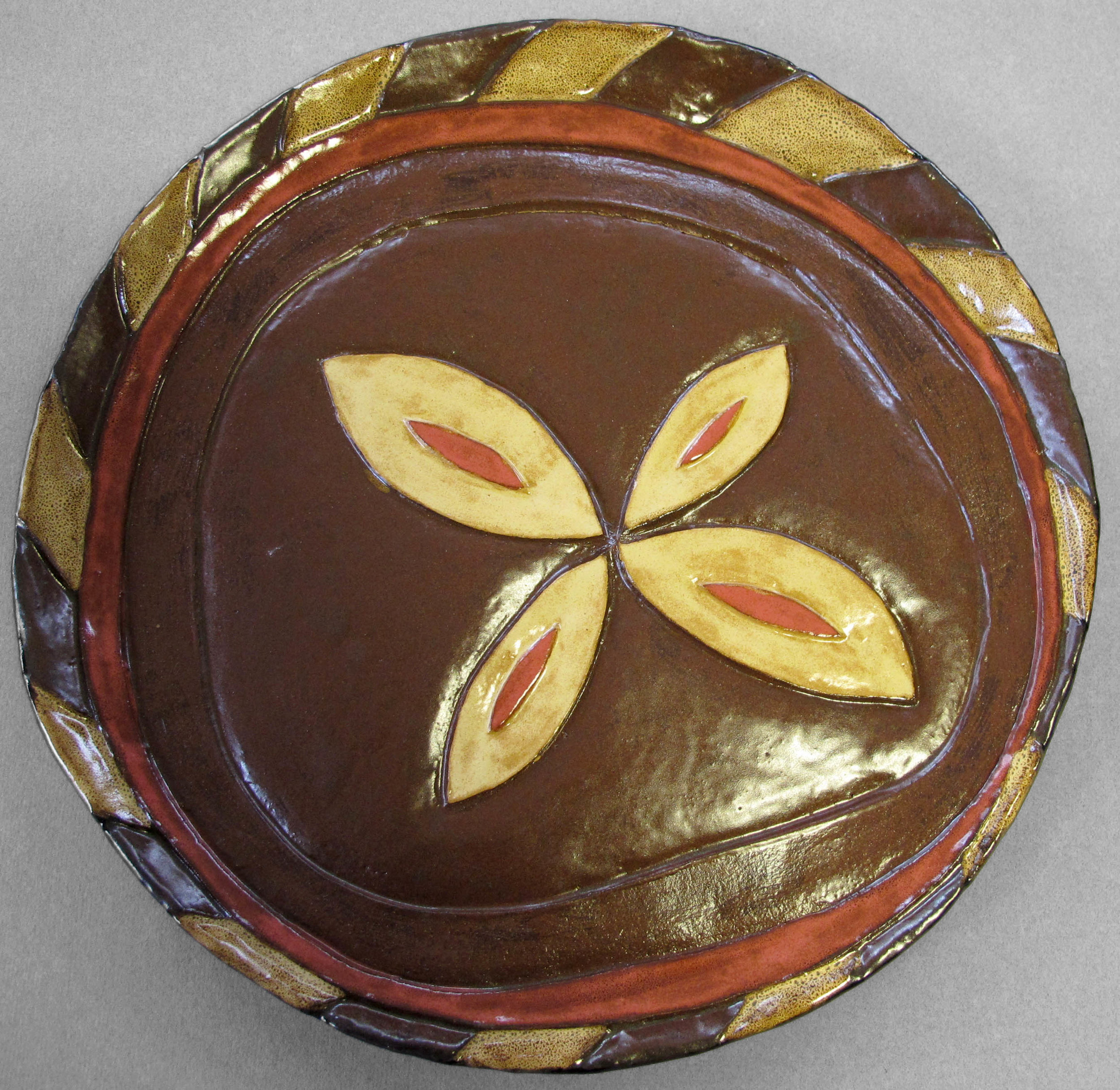YELLOW ON BROWN FLOWER PLATE