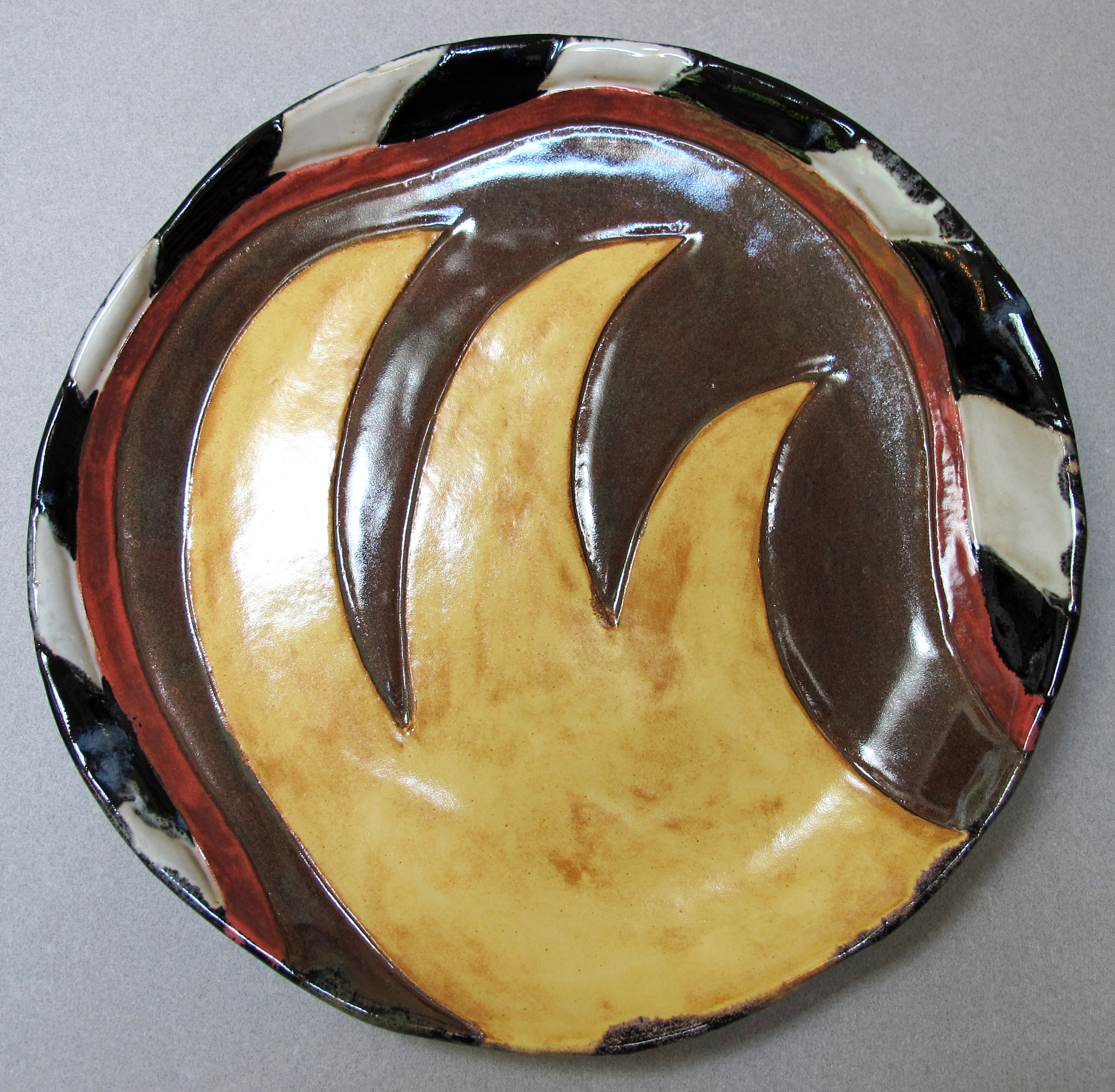 YELLOW WAVES ON BROWN PLATE
