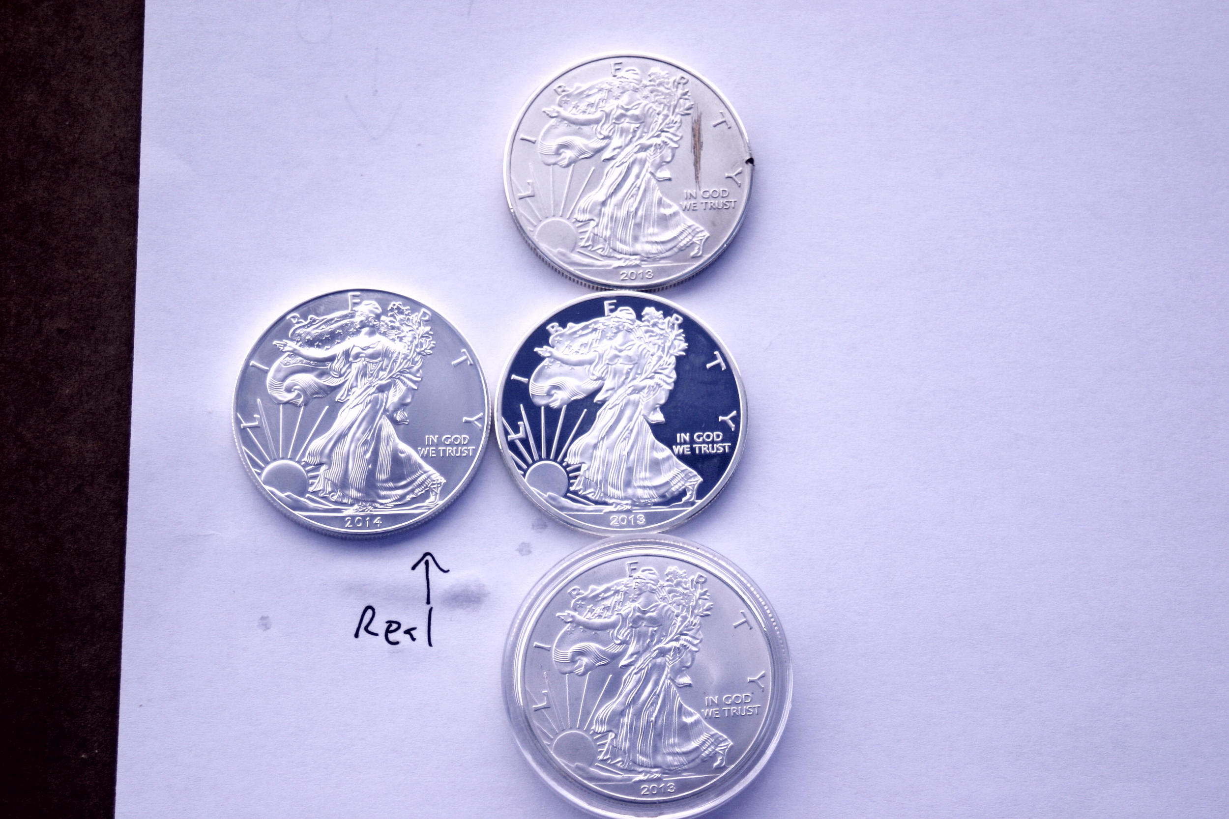 counterfeit american silver eagles.JPG