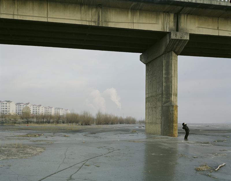 Man Doing Morning Exercise Under the Bridge with Mask, Ningxia, 2010