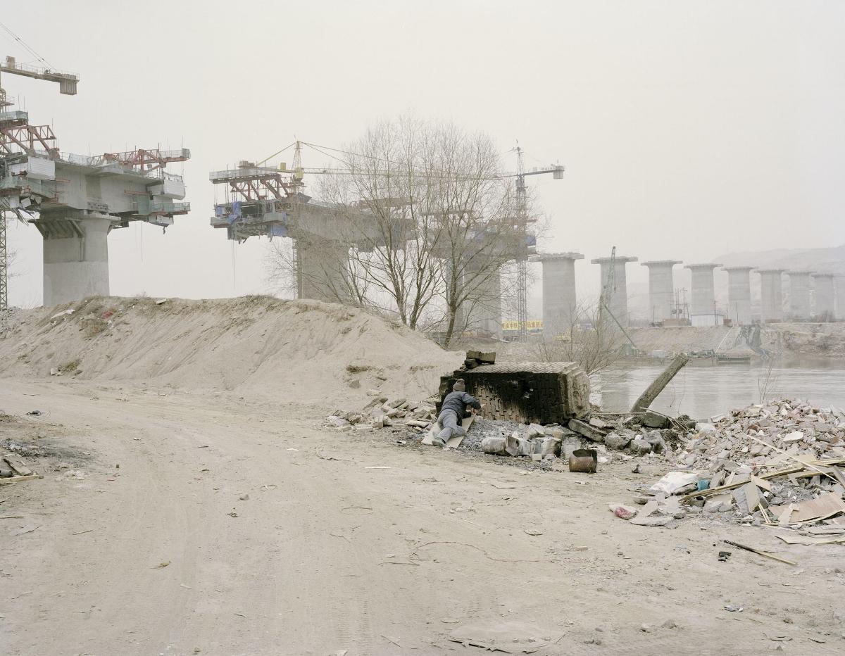Workers Taking Midday Rest beside a Bridge, Gansu, 2010
