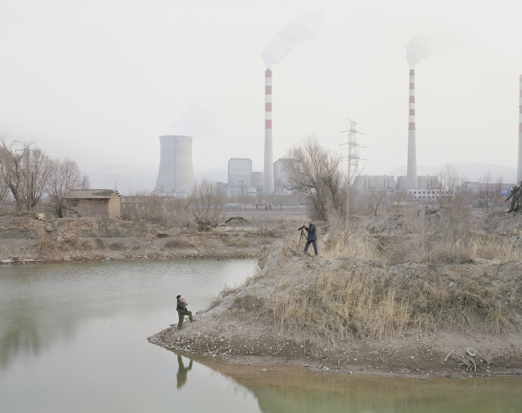 Two Men Taking Photos by the River, Gansu, 2010