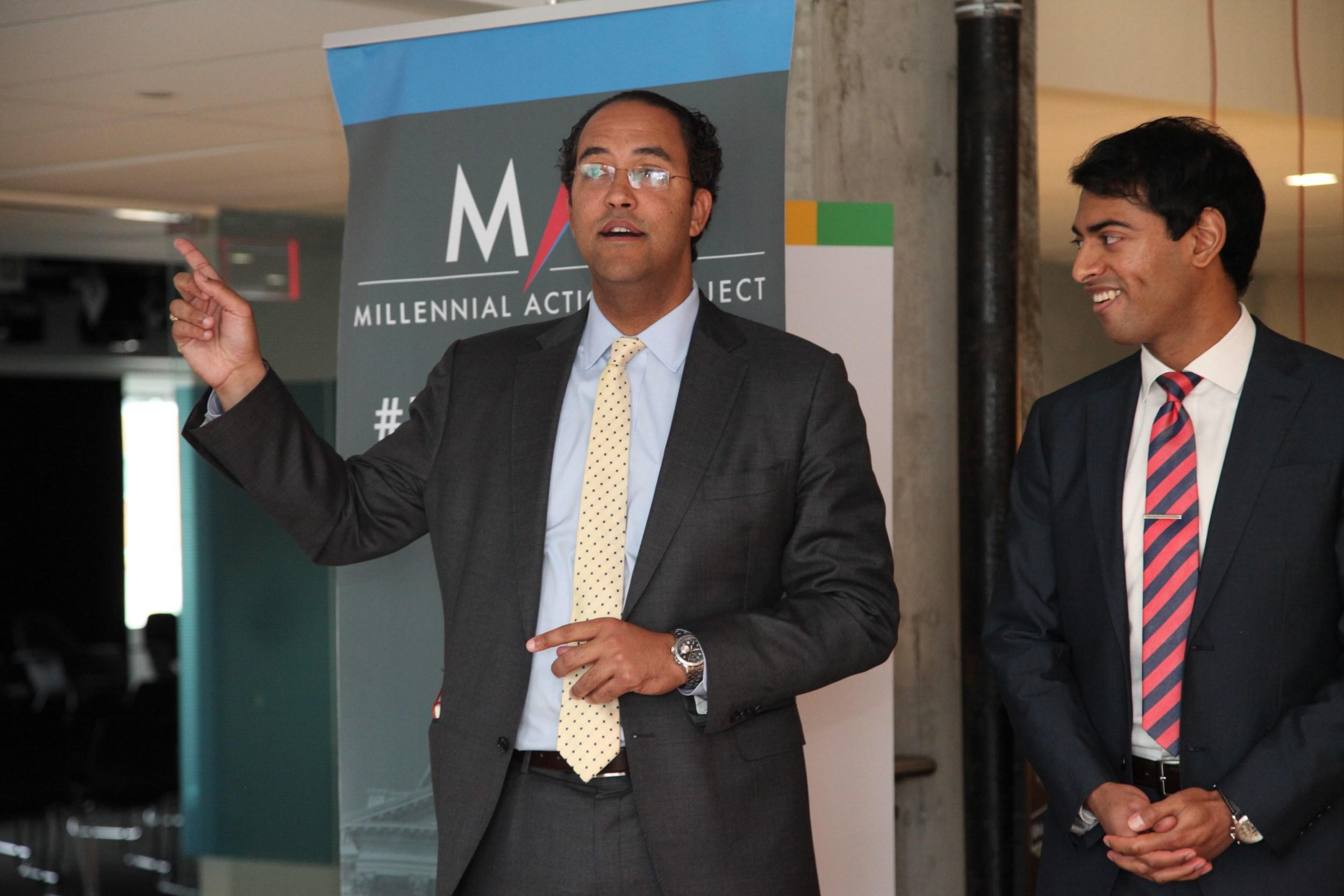 From left to right: Congressman Will Hurd addresses members of the public next to MAP President & Co-Founder Steven Olikara. © Liz Gorman