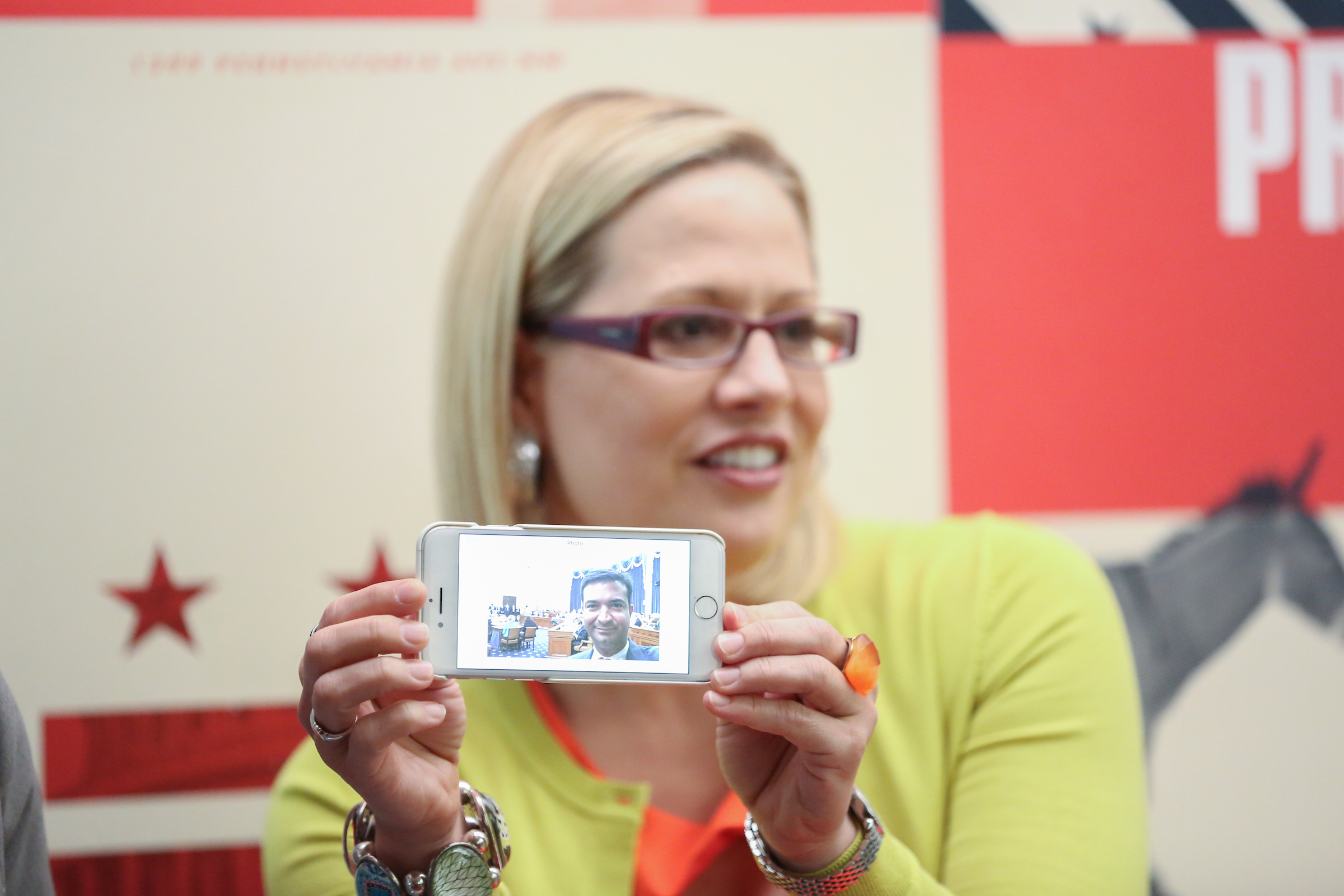 Rep. Sinema shares a photo texted to her by Rep. Curbelo, who was unable to attend the event due to a hearing in the House Ways and Means Committee. (Credit: Ralph Alswang Photography)