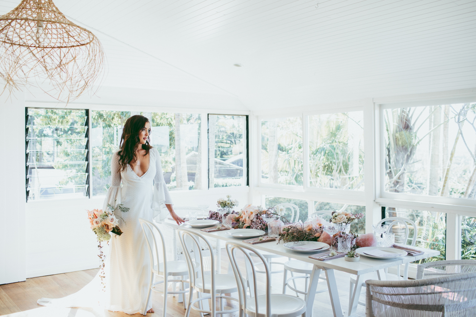 Byron Bay has its own special kind of soulful beauty and our recent styled shoot 'Coastal Romance' captures the iconic ocean, earth and romantic vibes that having your wedding in this region has to offer.  As we shift into the warmer months, this tablescape full of subtle pink and purple pastel hues and green succulents set the tone for a romantic summer soiree. The soft, delicate floral details with glimmering rose quartz (the 'crystal of love') and amethyst crystals encompass a dreamy, luminous atmosphere. The unique barnacle clusters and crystal elements tie together the ocean and earth creating an effortless, luxurious feel to your tablescape.  The lush, green rolling hills that surround Byron Bay make for the perfect setting to use white decor and distinctive, colourful textures. We have expanded our range to include plenty of neutral furniture options that can really help transform a venue space and make it a breeze for styling. We're also excited to offer these gorgeous barnacle clusters and crystals for hire. It's these individual details and textures that really provide that extra wow factor to your wedding day.  Scroll down for inspiration.