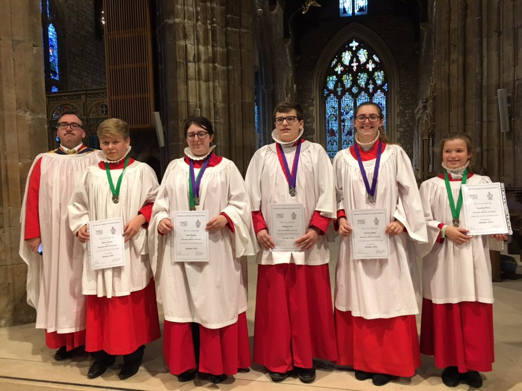 Five choristers from Doncaster Minster celebrate passing their Voice for Life exams.