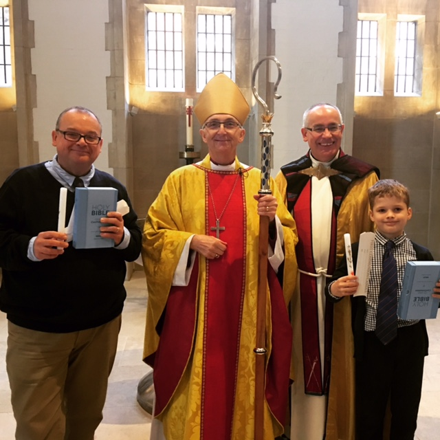 Stephen Hillier and his son Seth with the Bishop of Doncaster Peter Burrows and Canon Missioner Keith Farrow.