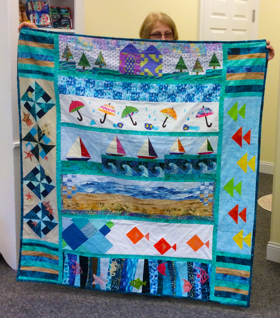 Barbara Dorry from Sandy Hook, CT with her Row by Row H20 quilt.
