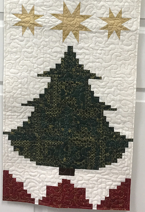 Log_Cabin_Christmas_Tree_Run_Thumb.jpg