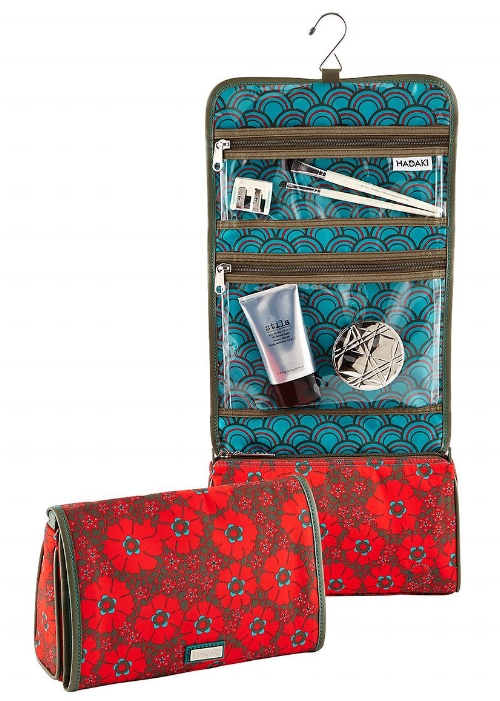Lace Hanging Toiletry Organizer    I love the  HADAKI  brand and the owners! I met these great group of girls from NOLA who have created a line of affordable and fashionable bags. All products are eco-friendly and simple to maintain, featuring water resistant and wipeable fabrics and finishes. This travel case will keep all your essentials together! Cute and functional, it has enough room for your travel-sized bottles and cosmetics.