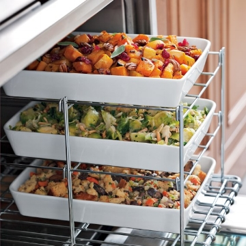 Even when you have a double oven, it always feels like you can use more oven space! This nifty   Three Tiered Oven Rack   is so helpful. You can bake several side dishes at the same time and there's even enough room for your main course next to it. Plus, it folds flat for convenient storage.