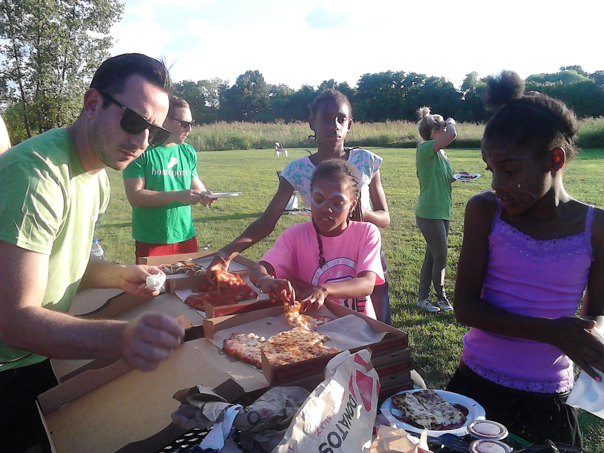 Dr. Josh Grosshandler dishes up pizza