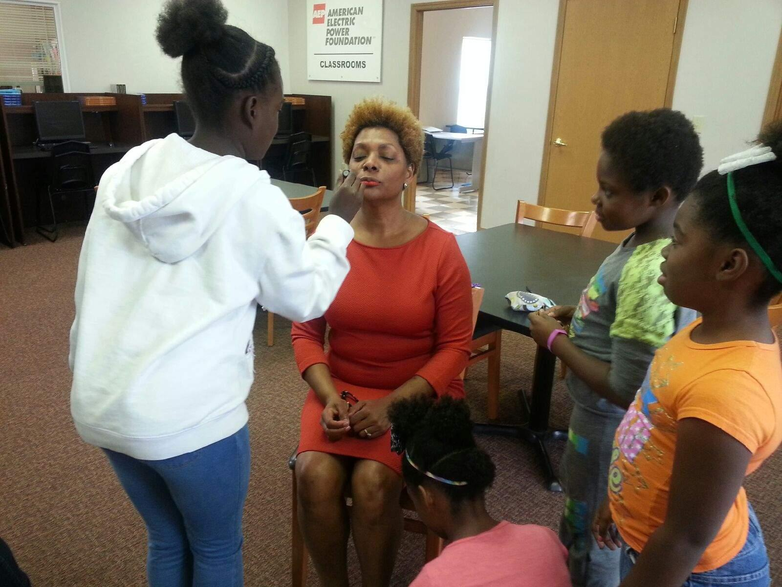 Resident children apply makeup