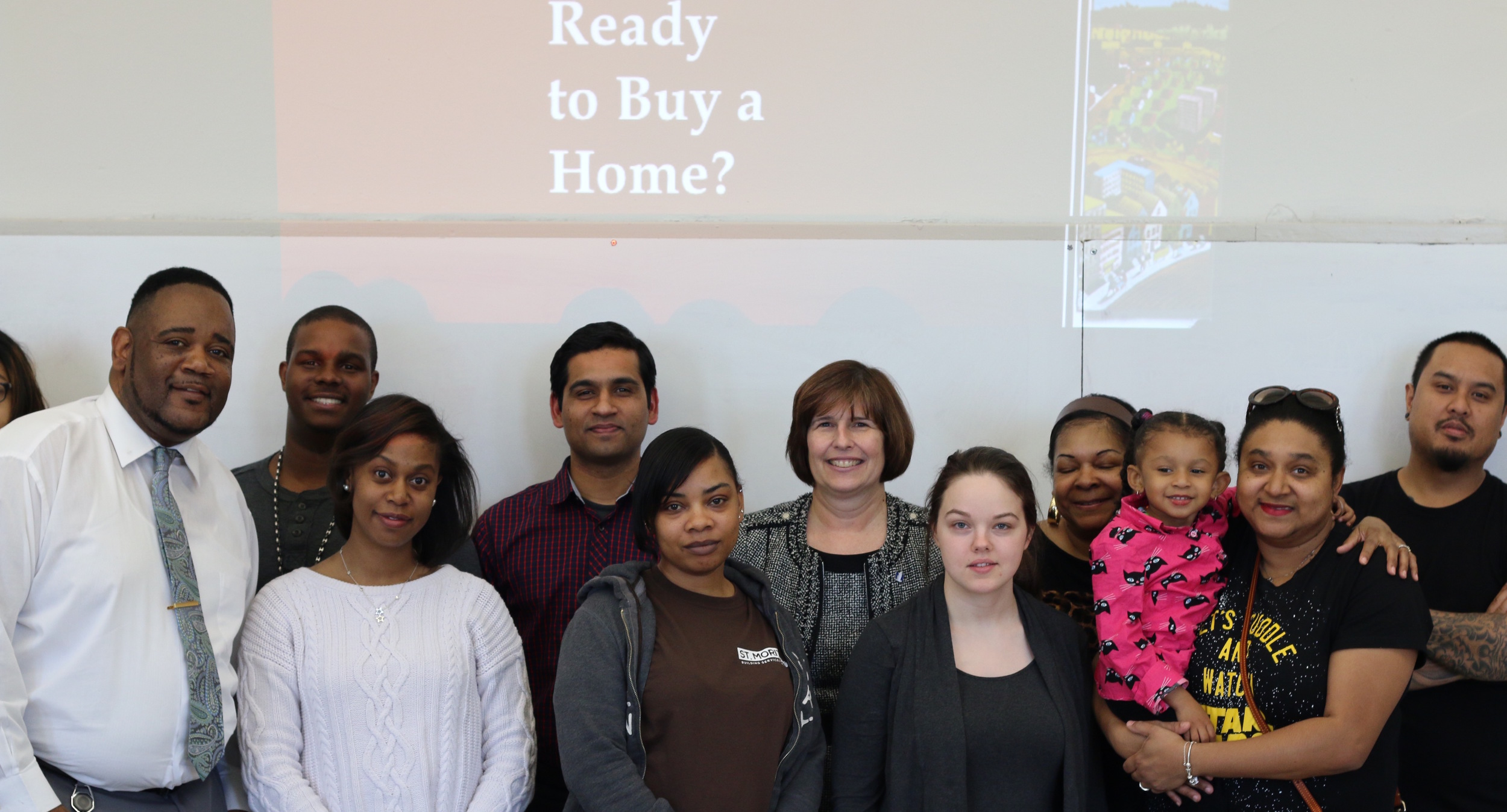 Karen Blickley, Nationwide Foundation VP, second row, center. Homeport Homebuyer Ed Counselor Kerrick Jackson, far left.