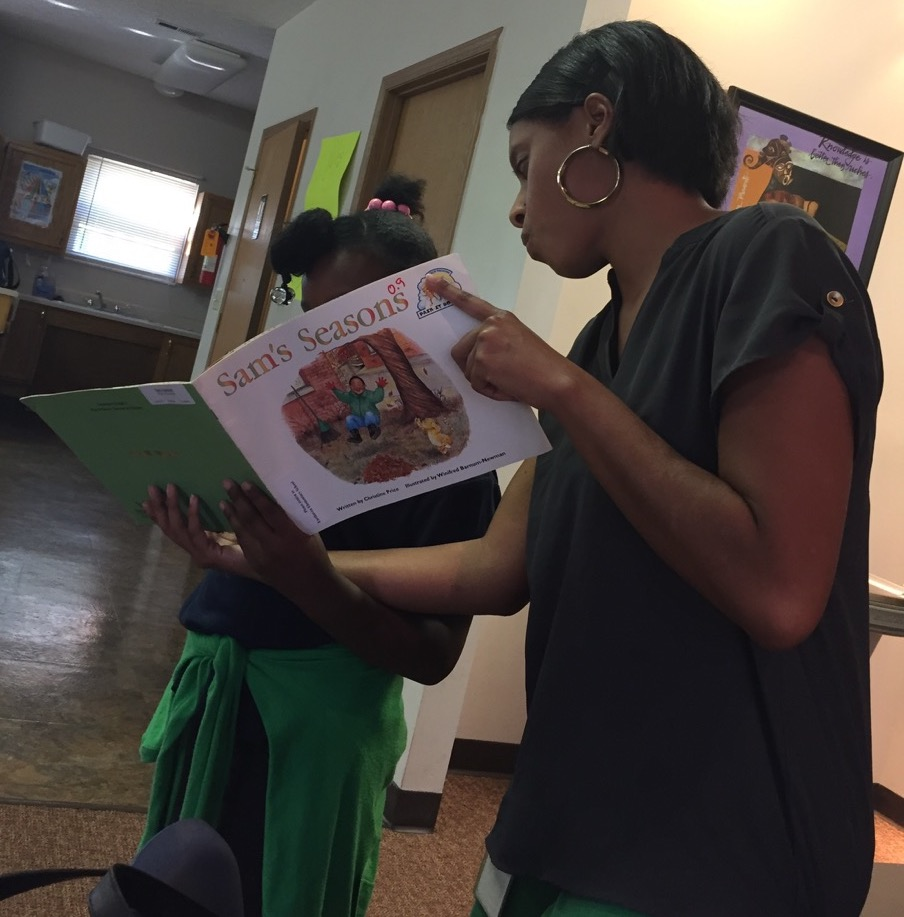 Jessica Williams reads to Marsh Run child in after school program.