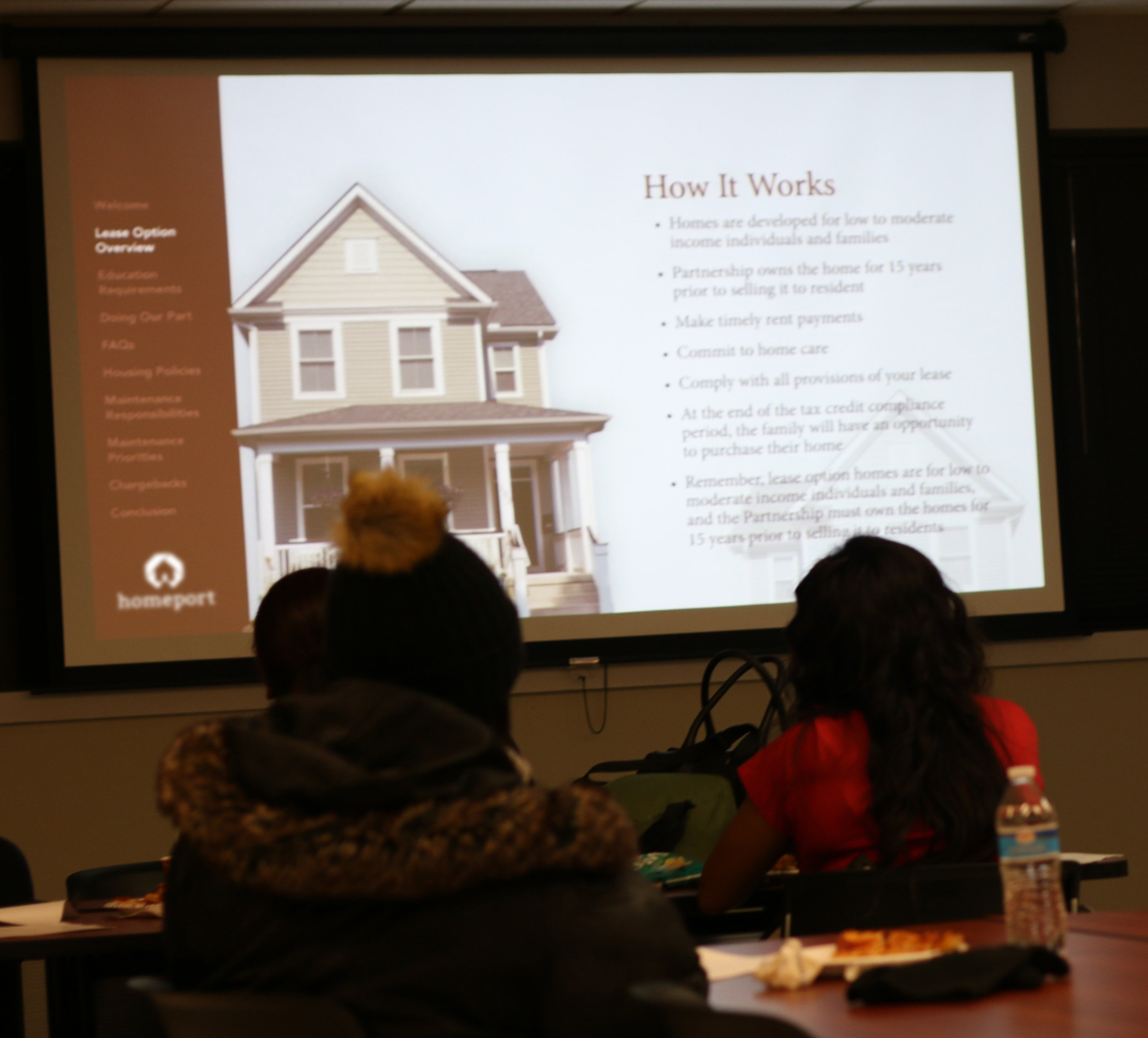 Potential homeowners from Kingsford Homes at meeting on how to purchase a home they are leasing from Homeport.