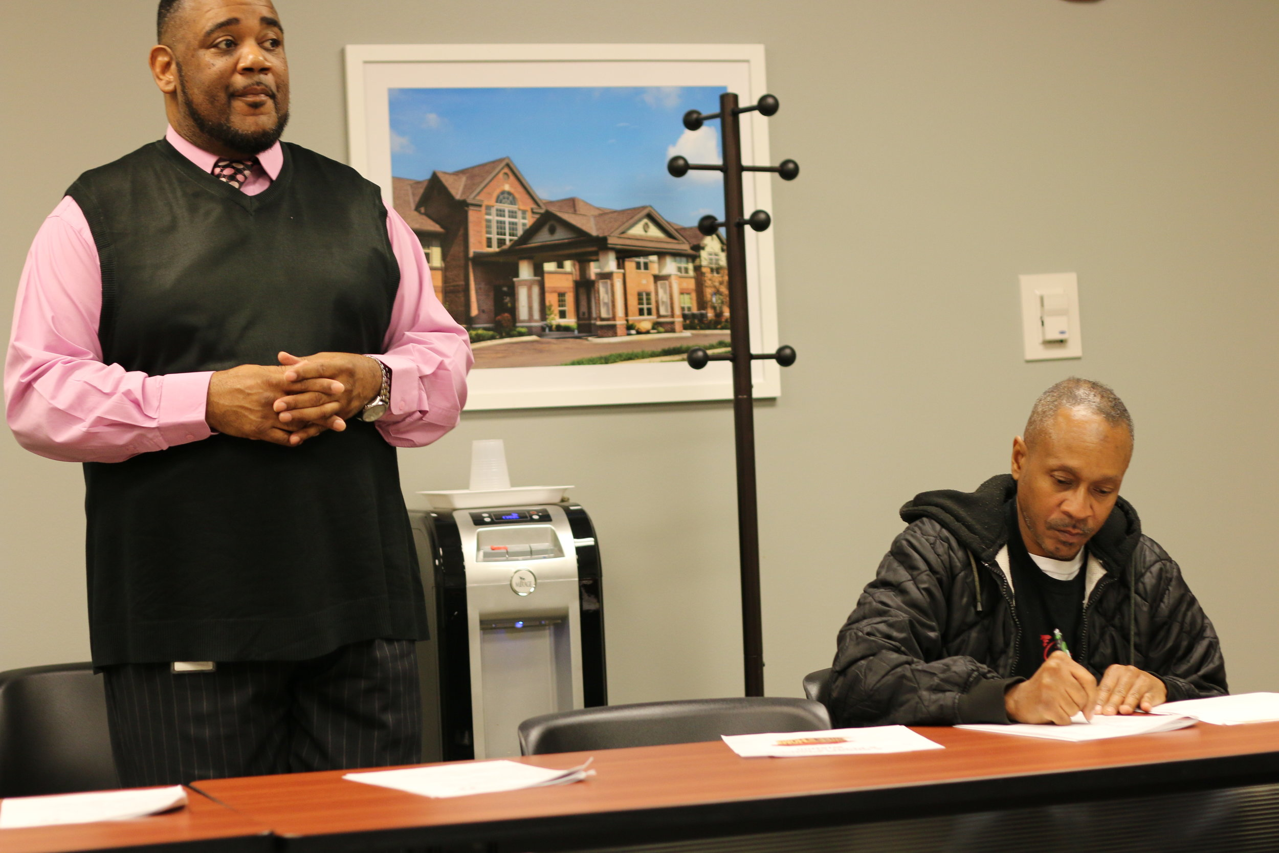 Homeport counselor Kerrick Jackson, left, at 'Readiness for Home Ownership' class.