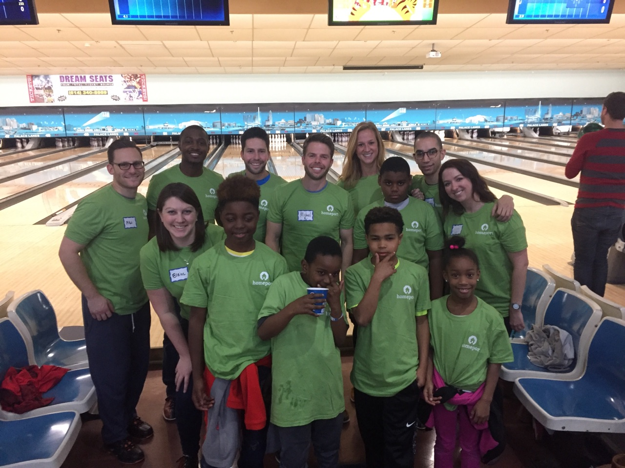 Organizers of the Homeport Young Professional bowling fund-raiser gather with Homeport resident children. The kids were chaperoned by   Homeport Program Specialist Mark Childs, second from left, top.