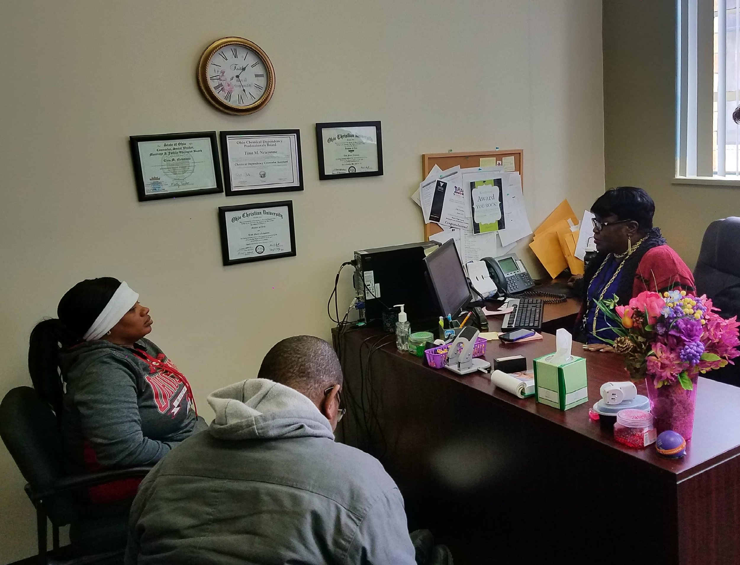 Veterans &Families First program clients meet housing counselor Tina Newsome.