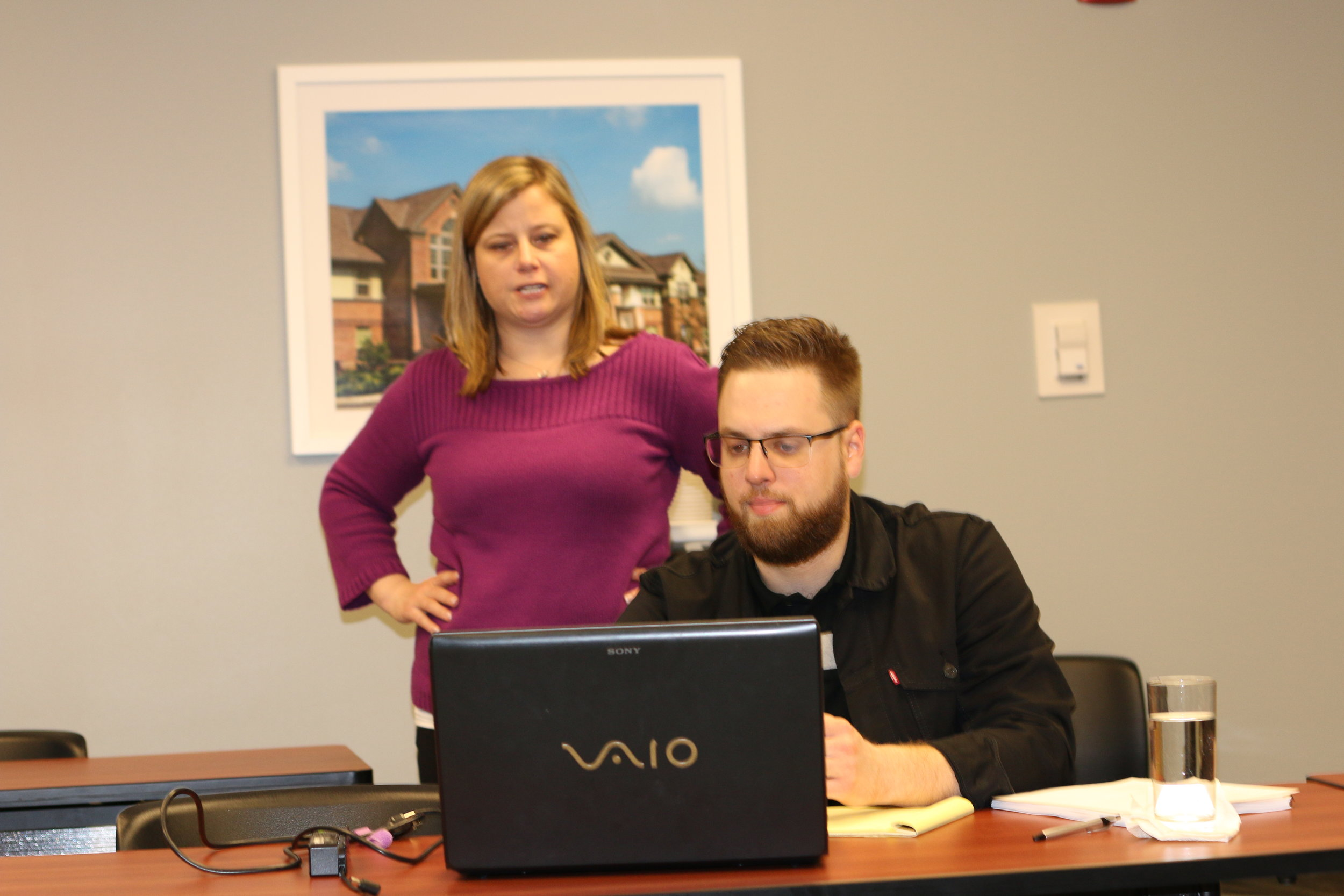 Homeport's Residents Services Department has been trained on United Way of Central Ohio's Care Coordination Network. Pictured above,De Andree Norris of United Way provides system lesson to Homeport Supportive Services Manager Lawrence Furst II.