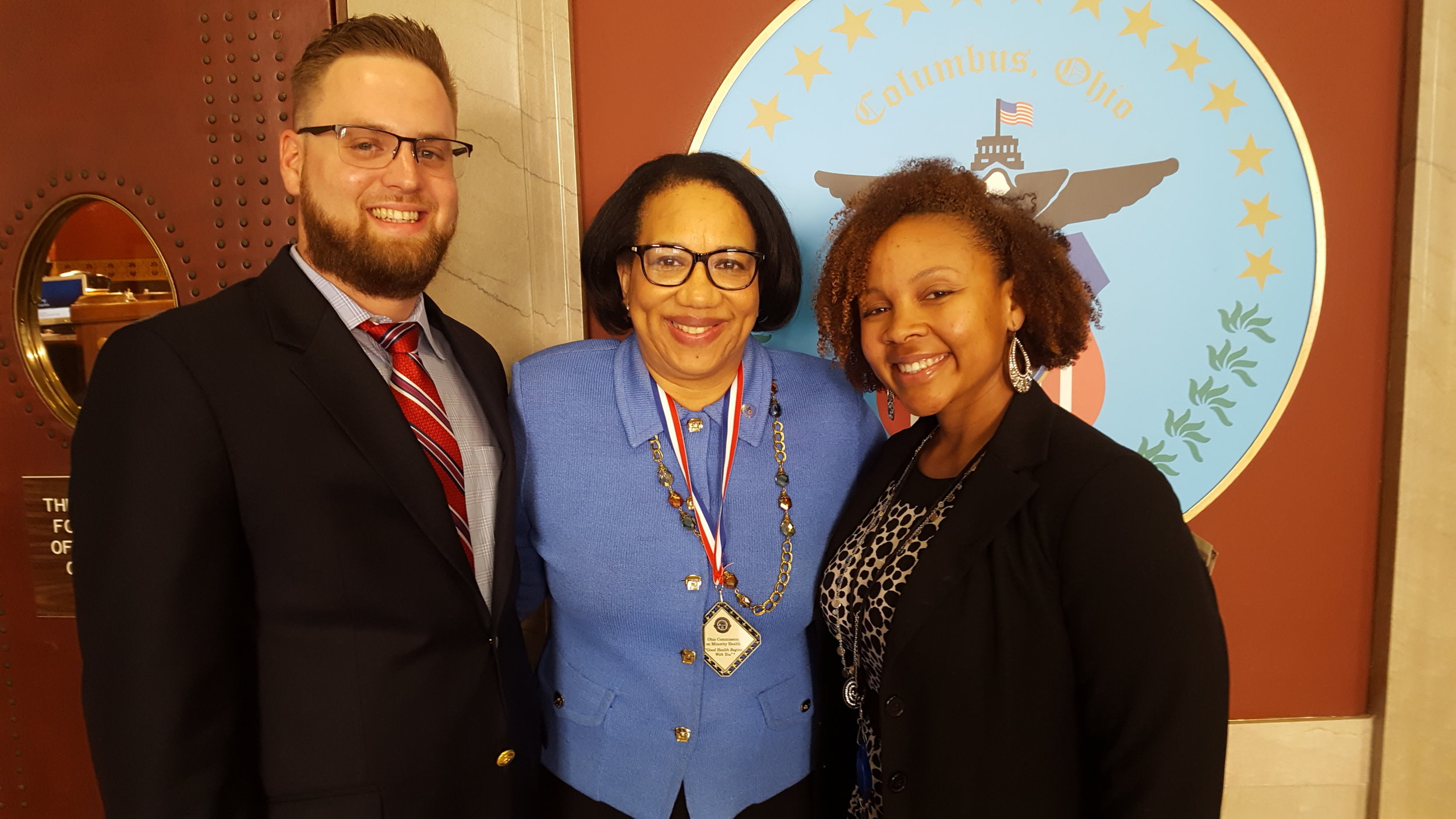 Homeport's Lawrence Furst II, left, Columbus City Council President Pro-Tem Priscilla Tyson and Amber Jones of Columbus Public Health outside council chambers.