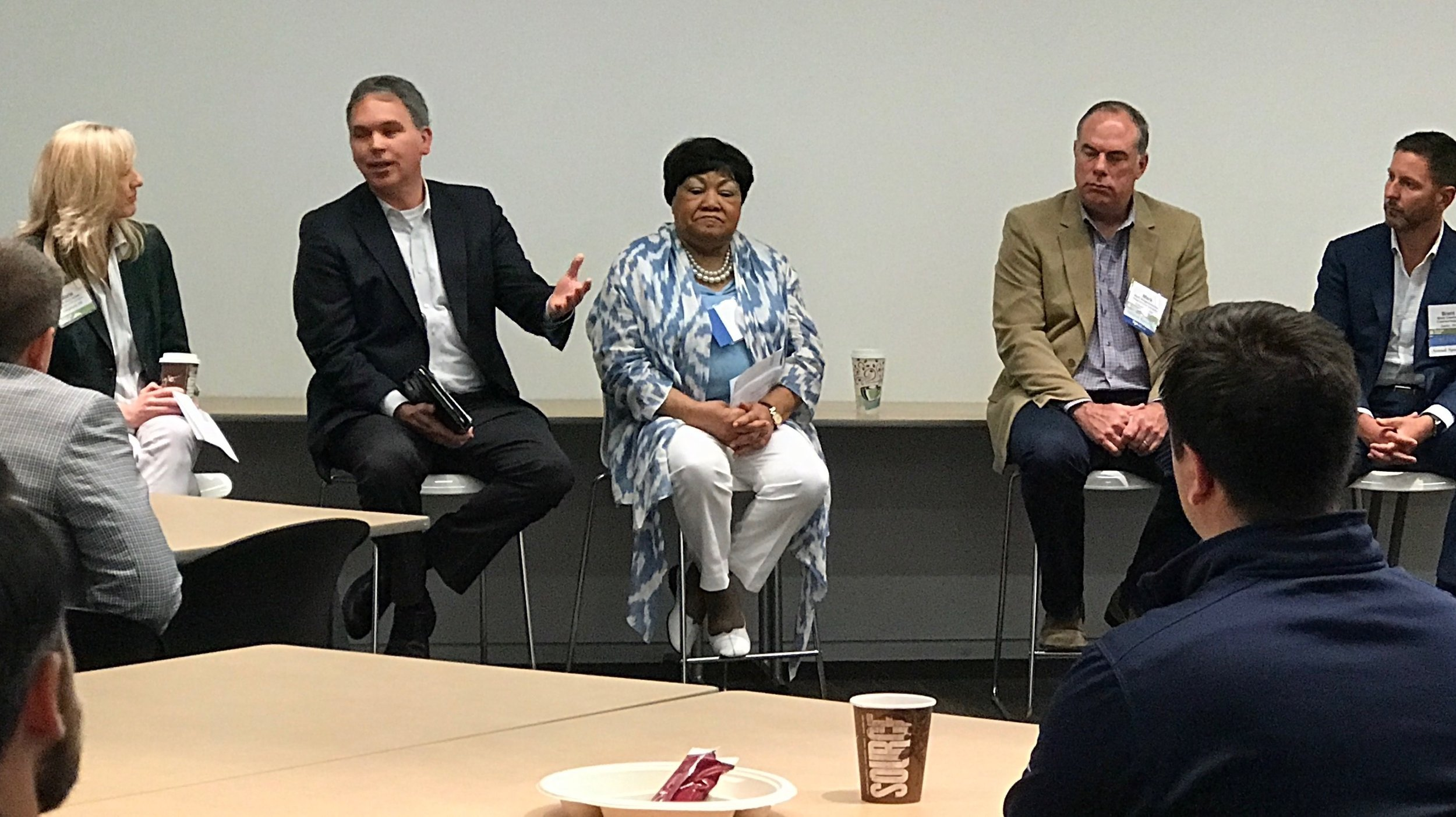 Maude Hill, center, Homeport's Senior Vice President of Community and Government Relations/Resource Development.