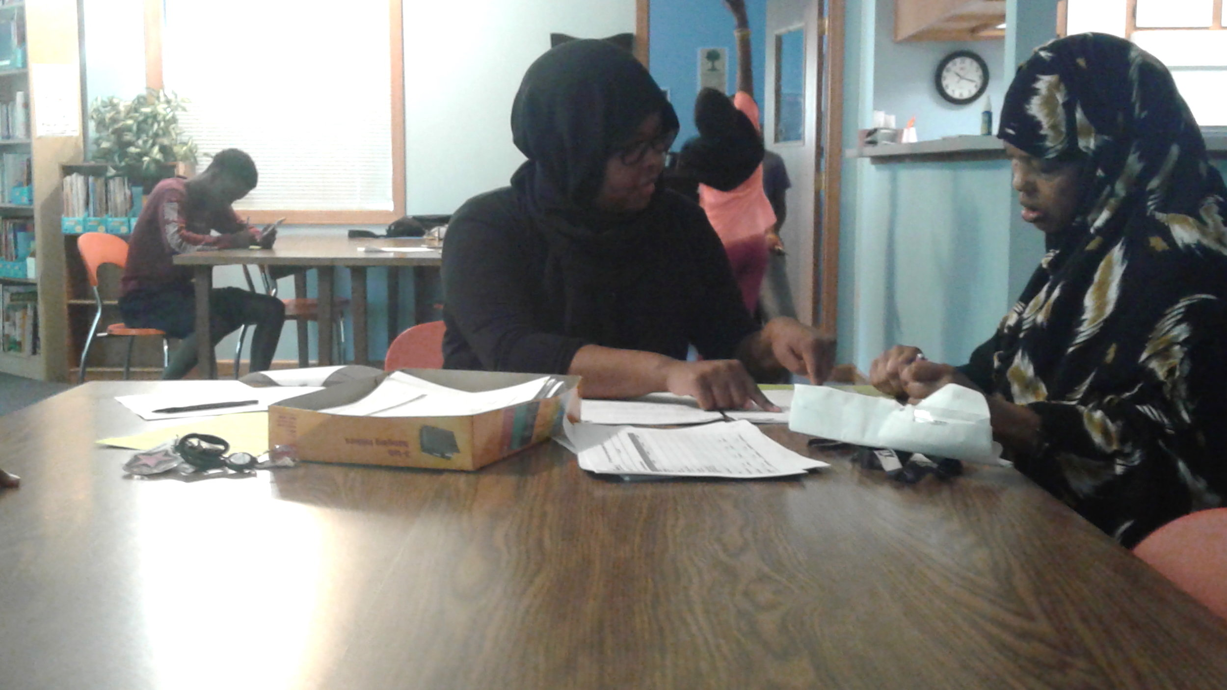 ETSS Site Coordinator Saynab Yusuf, left, at Emerald Glen summer camp registration