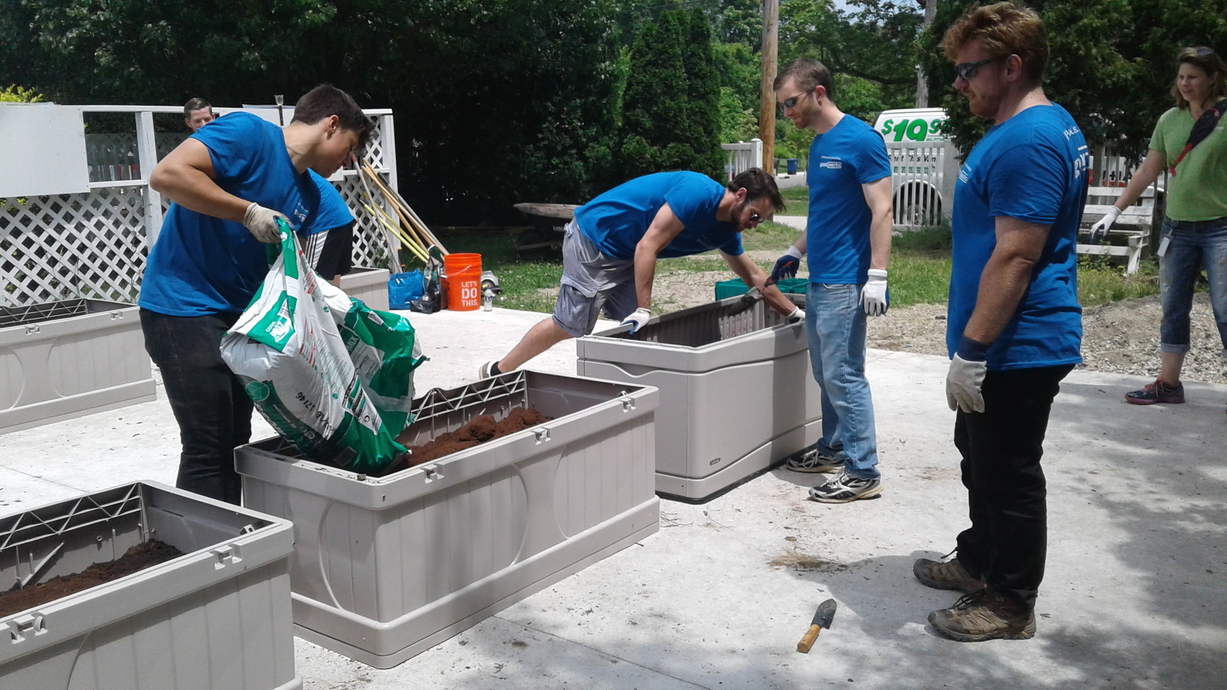J.P. Morgan Chase employees building flower beds.