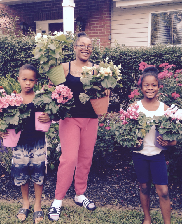 Emerald Glen resident Shelia Cunningham, and children Shamar Jenkins and Vermari Davis, participated in the flower give-away for the first time.