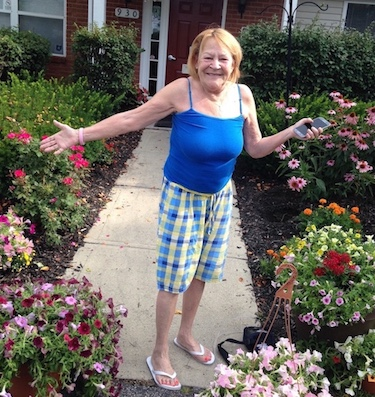 Emerald Glen resident Mary Stevens picked up flower for the 11th year.
