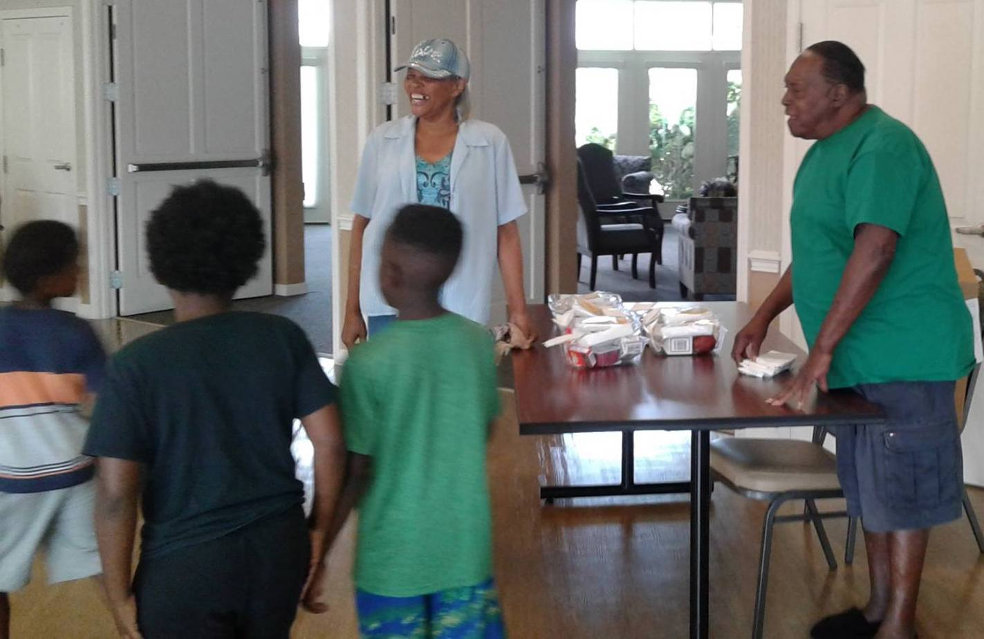 Kids ready for lunch handed to them by Elim residents.