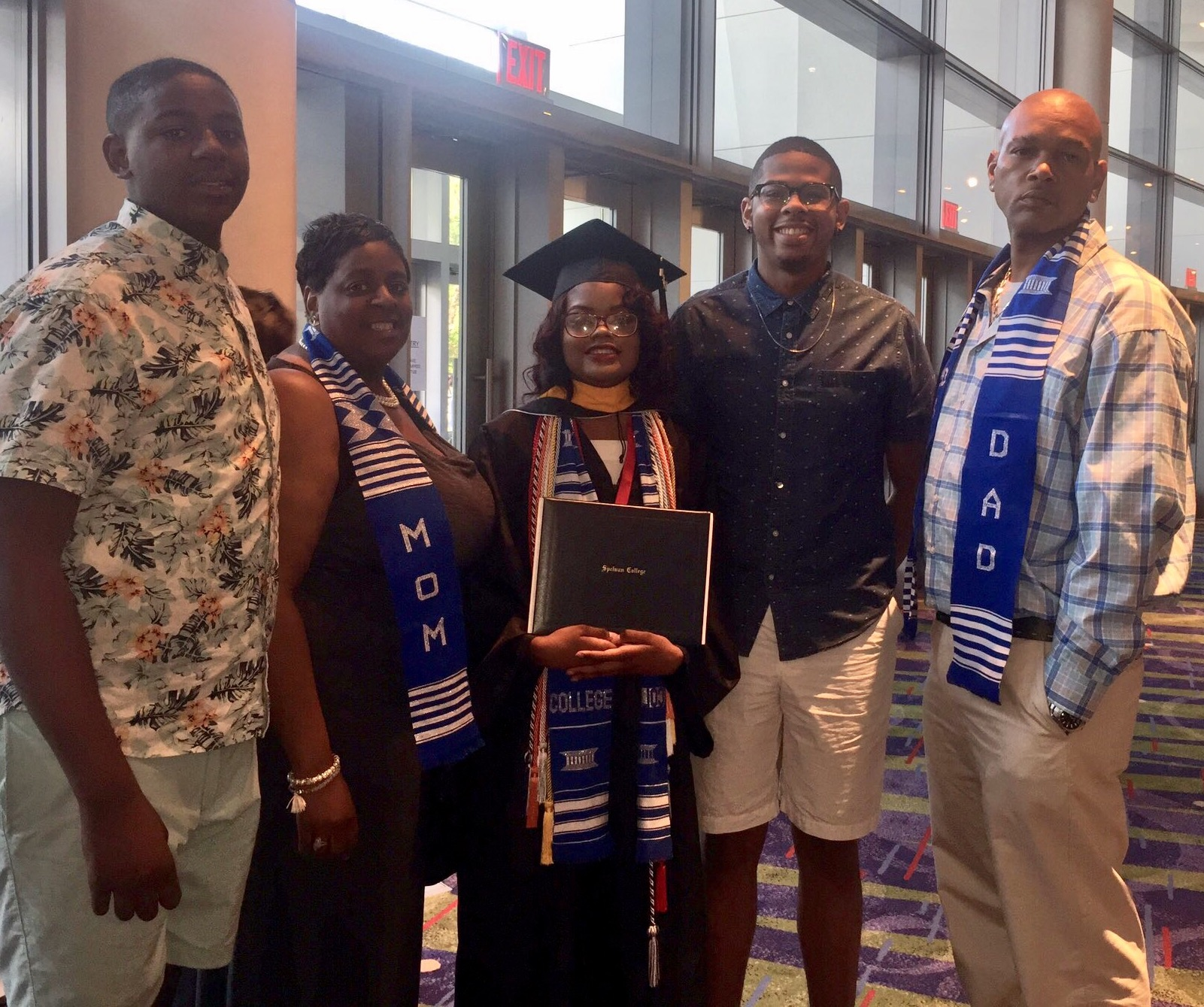Taylor Williams-Hamilton surrounded by family after graduation from Spelman College.