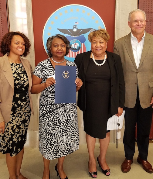 Mary Warren, second from left, outside Council Chambers. On left, Council Member Jaiza Page. On the right, Homeport Senior VP Maude Hill and Homeport President & CEO Bruce Luecke.