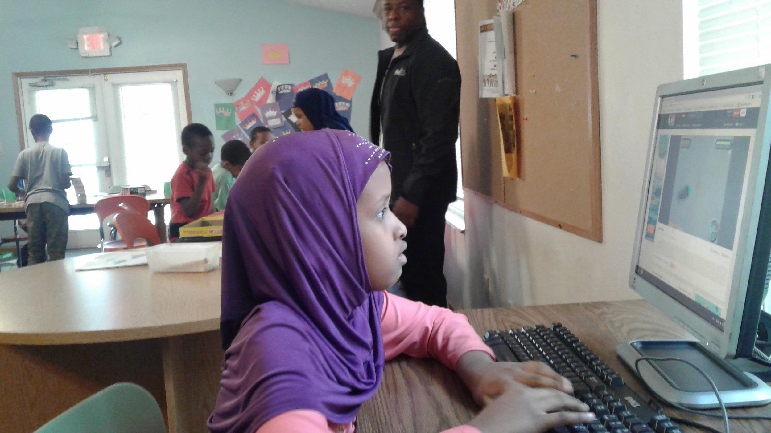 Ladan Yusuf plays computer game in Emerald Glen community center.