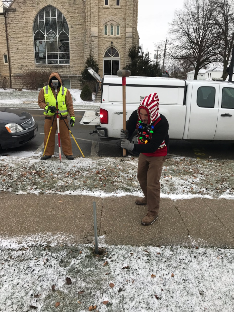 EMH&T Land Survey Crew Chief Adam Mulbarger confidently working in his assigned Ugly Sweater.
