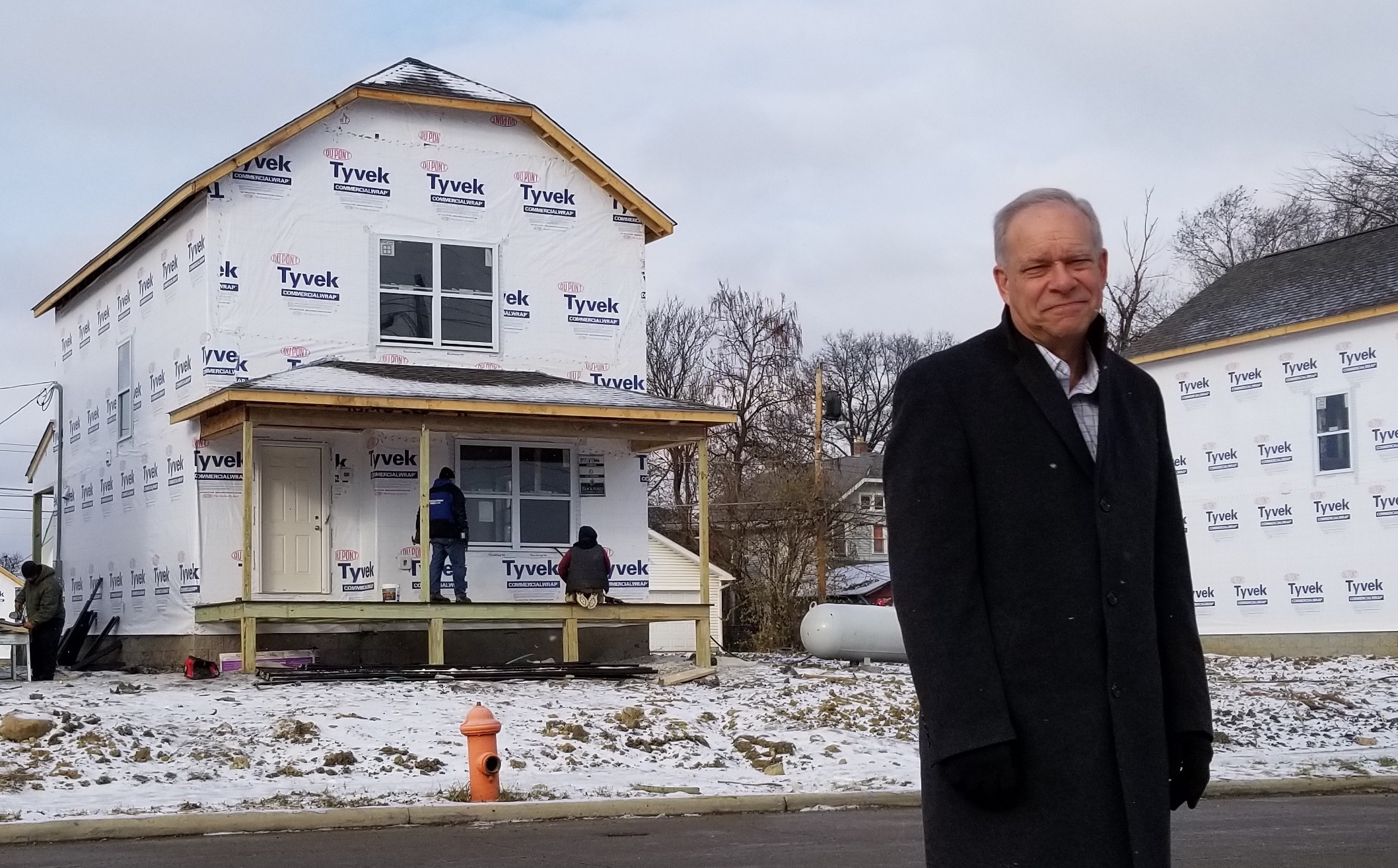 Bruce Luecke outside a Homeport house under construction in Milo-Grogan.