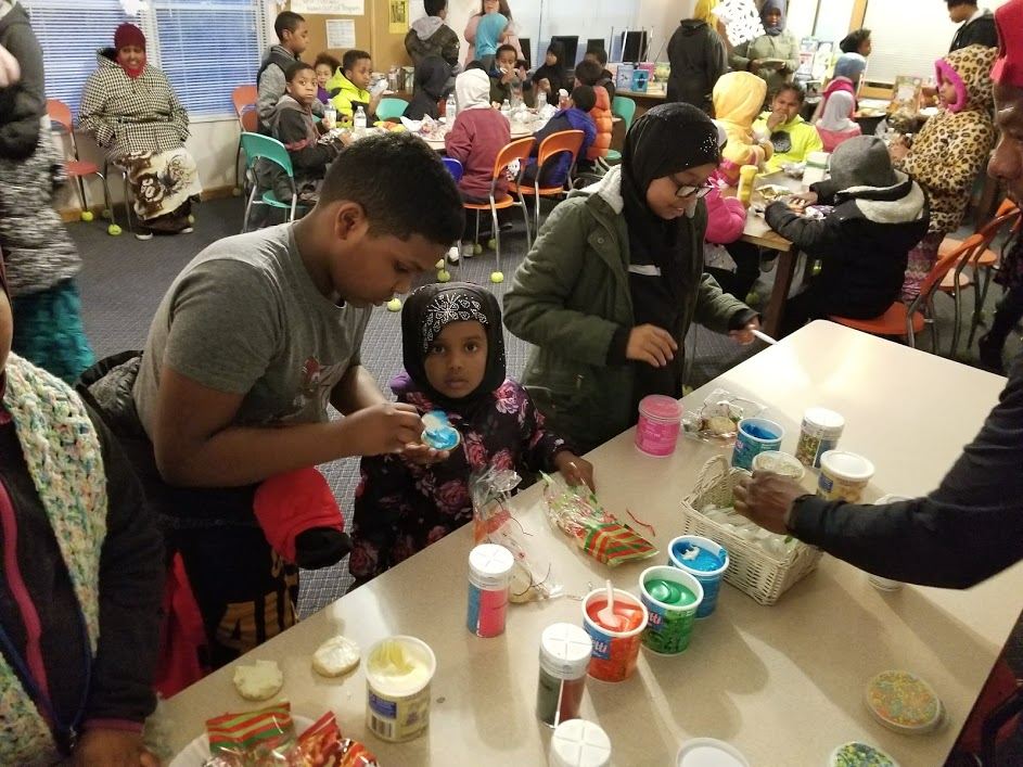 One hundred residents of Emerald Glen participated in writing and arts activities including, above, decorating cookies.
