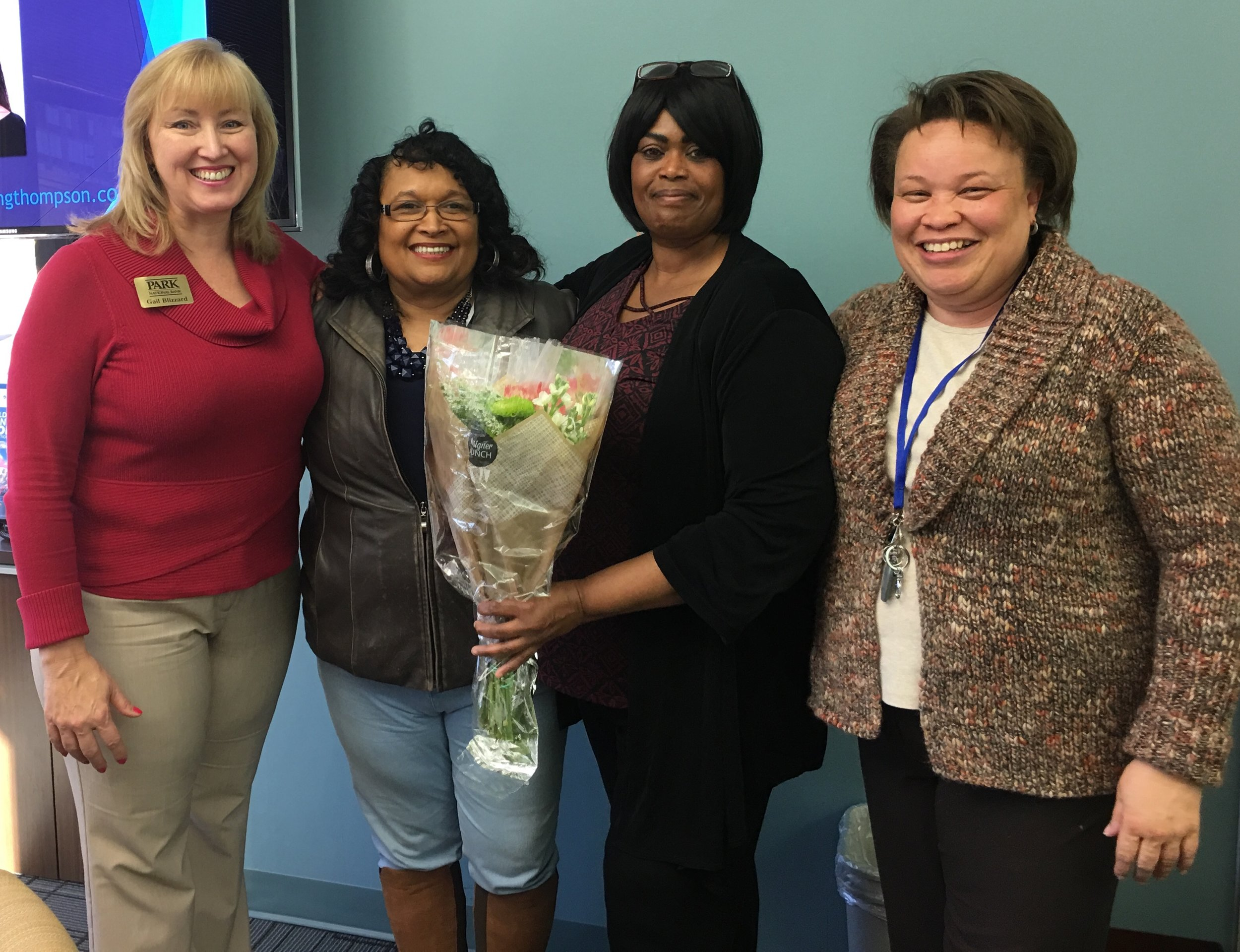 Greater Linden Homes resident Sherry White, second from right, at her closing in December.