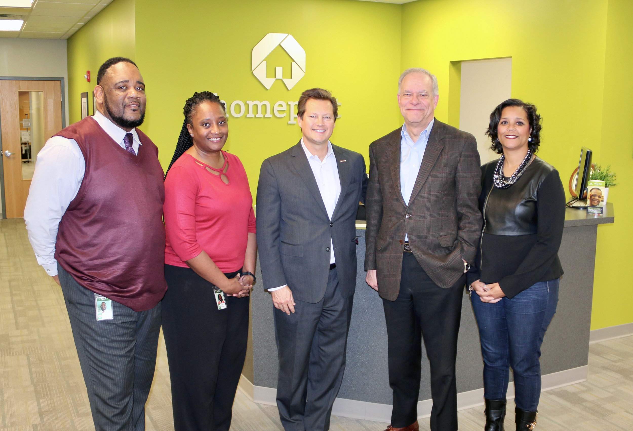 Steve Bennett, center, Central Ohio Market President of US Bank, stopped by Homeport headquarters to drop off a grant donation of $10,000 to support homebuyer education courses offered by Homeport. Accepting on behalf of Homeport were Kerrick Jackson, Netta Whitman, on the left, and Bruce Luecke and Laverne Price on the right.