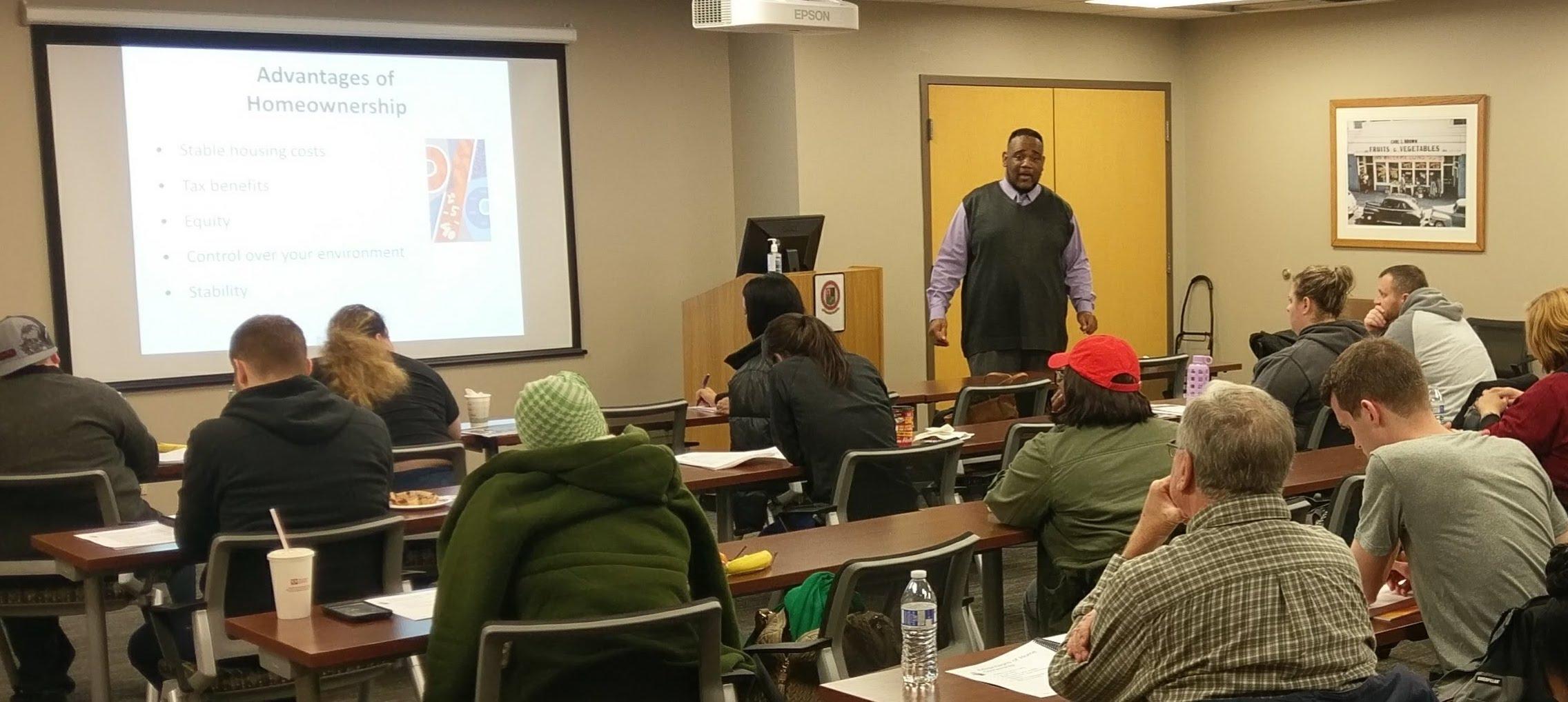 Homeport Housing Advisor Kerrick Jackson, far right, teaches class.