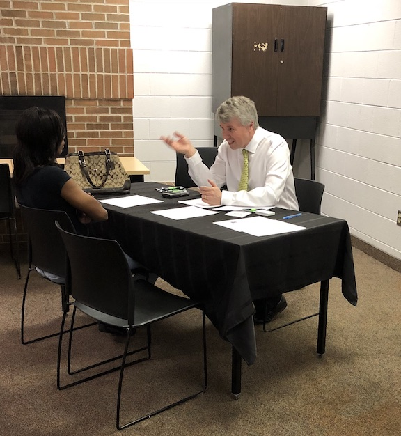Huntington Bank mortgage originator Mike Smith addresses potential home buyer from Joyce Avenue Homes.
