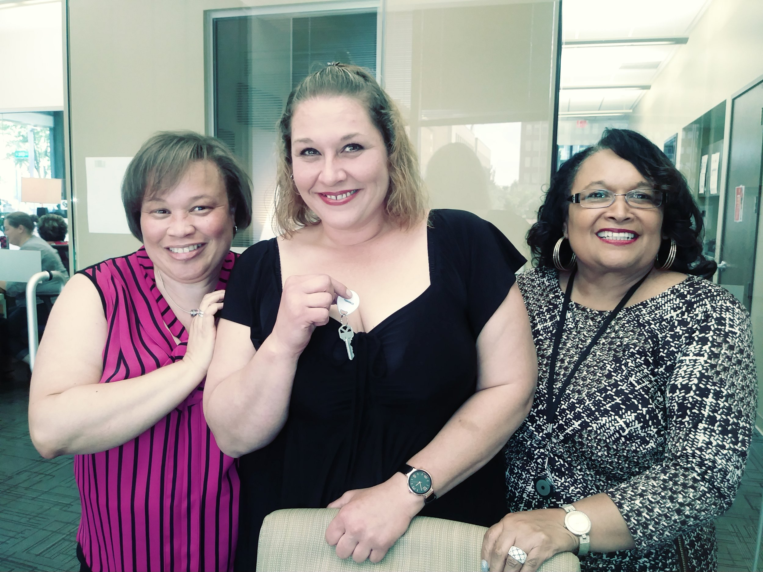 Maggie Parks at her home closing with Homeport's Brenda Moncrief, right, and Realtor Melle Eldridge of Coldwell Banker/King Thompson, left.