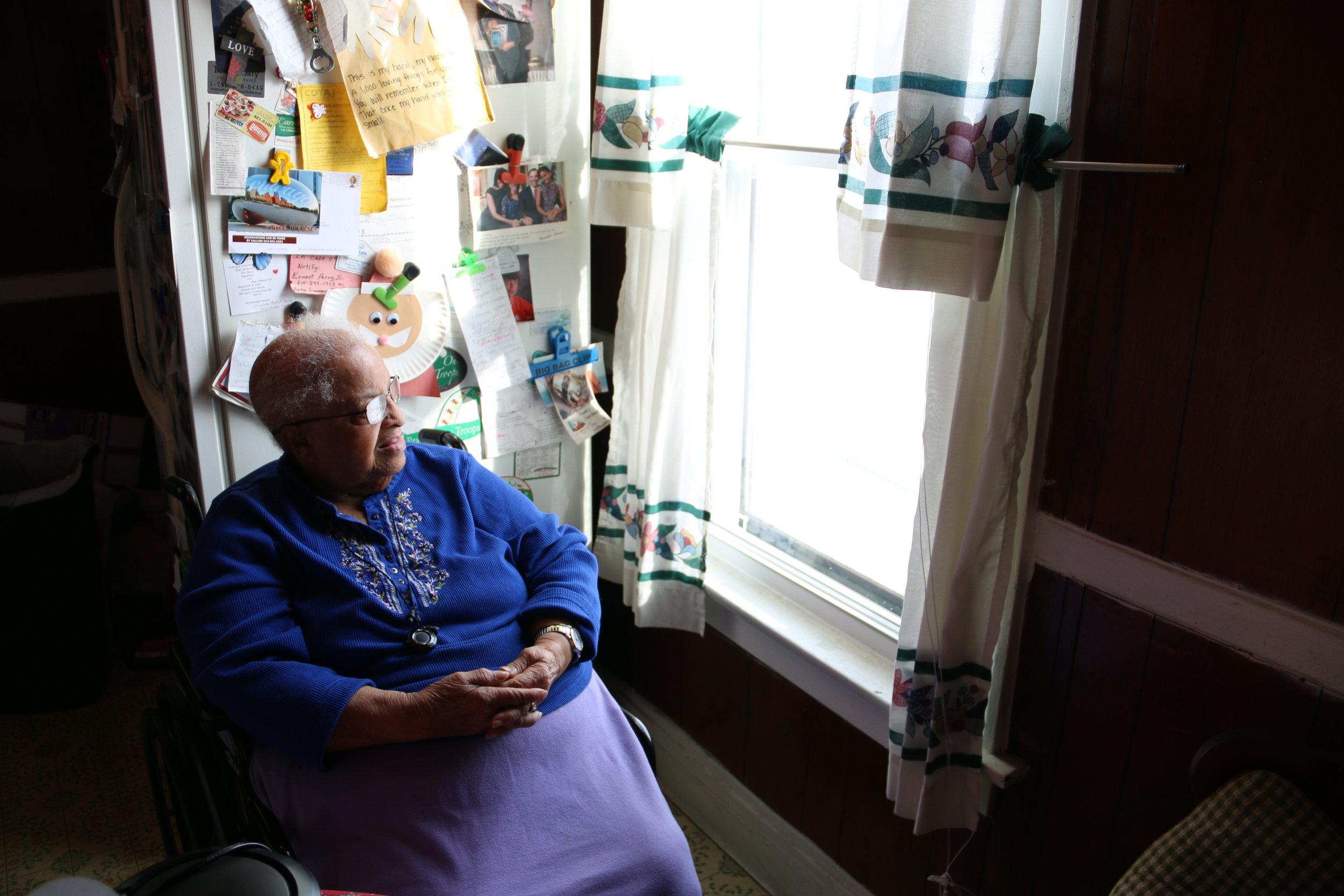 Fannie Lynch enjoys view from new kitchen window.